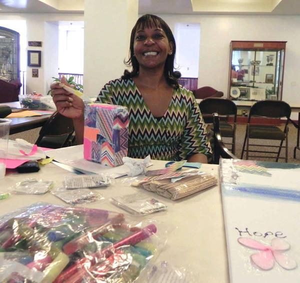Wilson College senior Yolanda Cabrera shows her painting skills Wednesday during Arts Day.