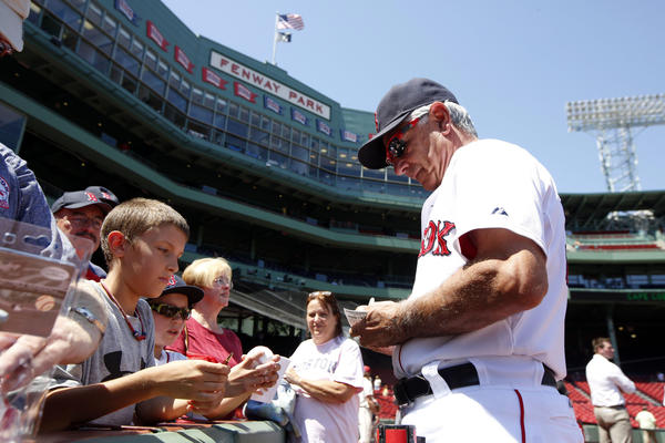 Bobby Valentine (25) signs autographs before the start of the game against the Toronto Blue Jays at Fenway Park in July.