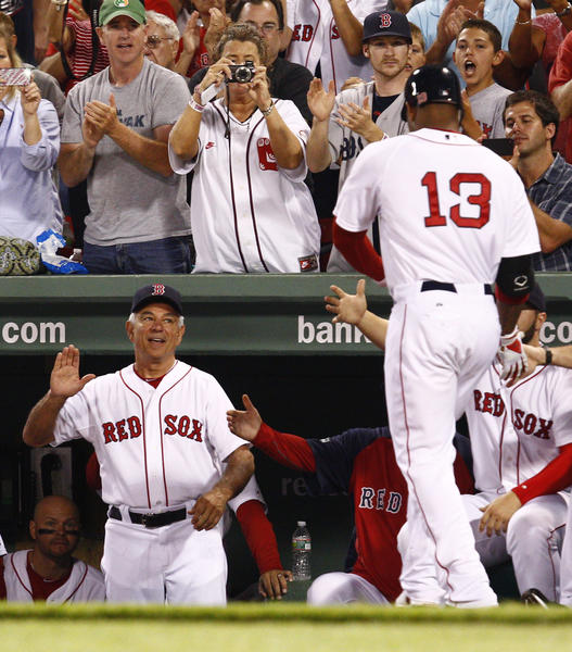 Bobby Valentine greets Red Sox left fielder Carl Crawford (13) after Crawford's home run  against the Detroit Tigers at Fenway Park in August.