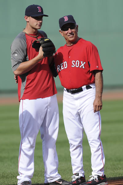 Red Sox third baseman Will Middlebrooks (64) and manager Bobby Valentine (25) chat during batting practice prior to a game against the Texas Rangers at Fenway Park.