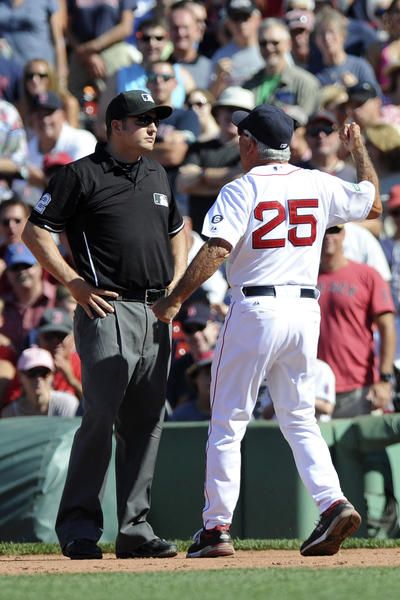 Bobby Valentine (25) argues a call with first base umpire Dan Bellino during the fifth inning against the Kansas City Royals at Fenway Park in August.