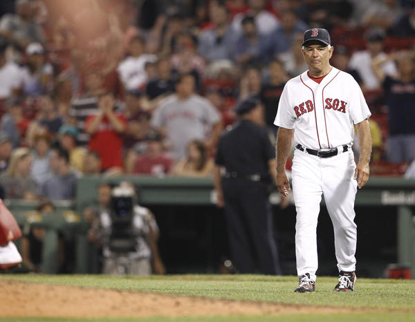 Bobby Valentine (25) comes out to remove starting pitcher Clay Buchholz (not pictured) during the sixth inning of a game against the Los Angeles Angels at Fenway Park in August.
