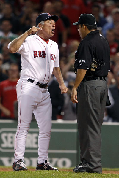 Bobby Valentine (25) talks with the umpire after right fielder Cody Ross (not pictured) struck out by New York Yankees relief pitcher Rafael Soriano (not pictured) during the eight inning at Fenway Park in September.
