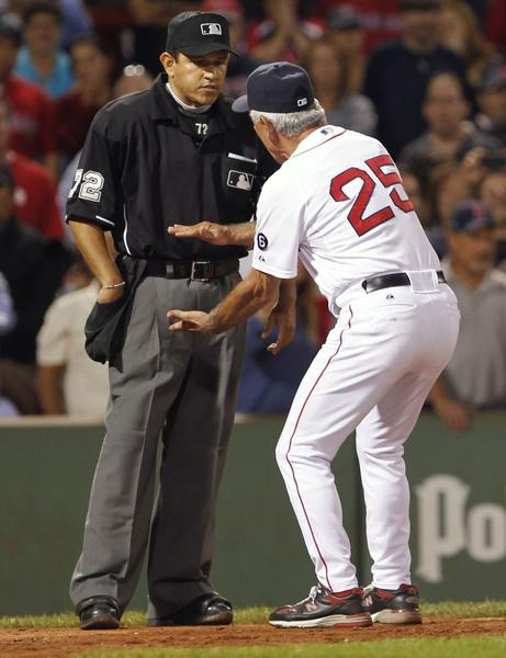 Bobby Valentine (R) argues with home plate umpire Alfonso Marquez after Red Sox's Cody Ross (not pictured) was called out on strikes against the New York Yankees during the eighth inning of American League MLB baseball action at Fenway Park in Boston, Massachusetts September 12, 2012. Valentine was ejected from the game.