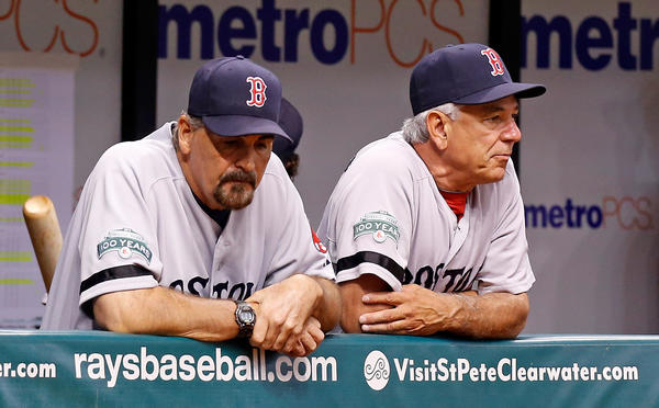 Pitching coach Randy Niemann #68 and manager Bobby Valentine #25 of the Boston Red Sox watch from the dugout against the Tampa Bay Rays during the game at Tropicana Field on September 19, 2012 in St. Petersburg, Florida.