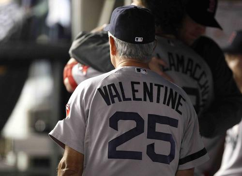 In what would be his final game as Red Sox manager, Bobby Valentine walks through the dugout prior to the start against the New York Yankees in their MLB American League baseball game at Yankee Stadium in New York, October 3, 2012.