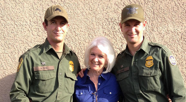 Nicholas Ivie, left, a Border Patrol agent who was killed at the Arizona-Mexico border, stands with his mother, Cheryl, and his brother Joel.