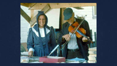 Alta Schrock and un-named fiddler at Springs Folk Festival, 1959.