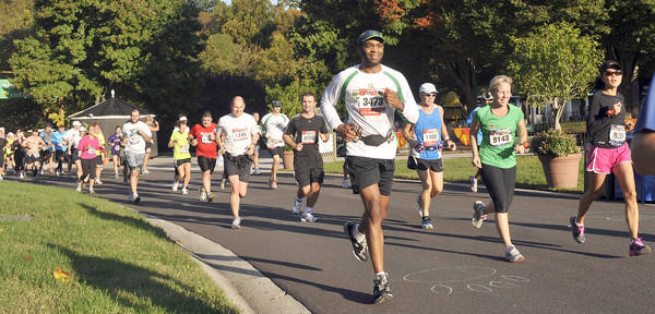 Participants in the 2011 Baltimore Running Festival run through the Maryland Zoo.