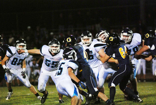 Petoskey senior Jordan Haggerty (from left), sophomore Kurt Boucher and junior Connor Reed converge on Gaylord quarterback Tyler Frisch. The Northmen will play host to Traverse City West at 7 p.m. Friday, Oct. 5, at Curtis Field for Petoskey's homecoming.