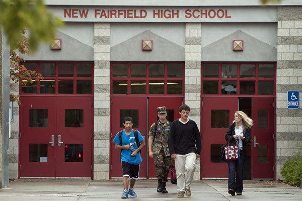 Students leave New Fairfield High School in Connecticut. Tyler Giuliano, a student involved in Civil Air Patrol at the school, was killed by his father, Jeffrey Giuliano, during what appeared to be an attempted burglary.