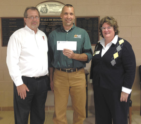 From left, Michael Flicek, executive director of the Hagerstown YMCA; Thomas Dudich of Warfordsburg, Pa., the grand prize winner; and Julie Barr-Strasburg, executive director of the Washington County Chapter of the American Red Cross.