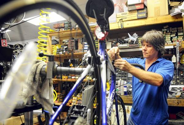 John Morrison, owner of Pembroke Cycle, works on a customer's bike Thursday afternoon in Pembroke Pines.