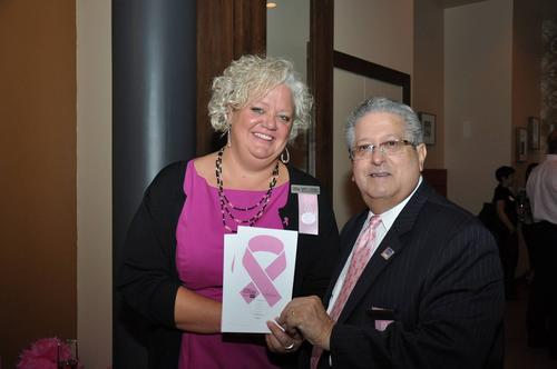 Mary K Twomey, Director of Sales & Marketing & Andrew Schwabel and General Manager Chicago¿s Essex Inn pose at an October event. On October 2, 2012, Chicago¿s Essex Inn gave the Michigan Avenue skyline a touch of pink to support Breast Cancer Awareness Month.