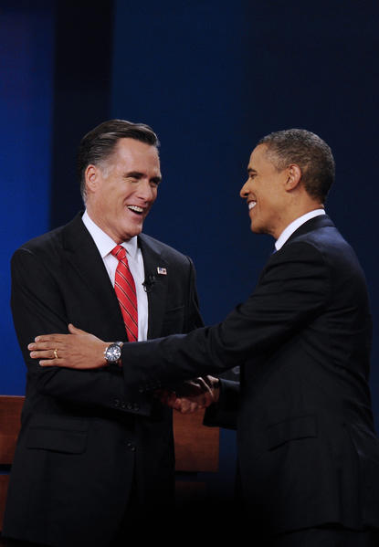 Mitt Romney and President Obama greet each other before the first presidential debate at Denver University on Wednesday.