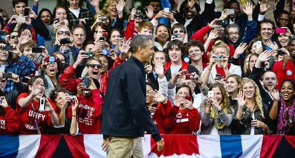 Supporters greet President Obama as he arrives to address a rally at the University of Wisconsin in Madison.