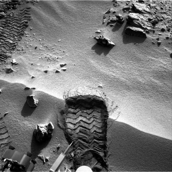 "NASA's Mars rover Curiosity cuts a wheel scuff mark into a wind-formed ripple at the ""Rocknest"" site to give researchers a better opportunity to examine the particle-size distribution of the material forming the ripple."