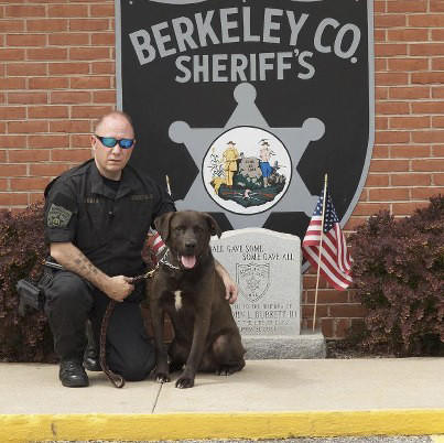 Berkeley County Sheriff's Deputy Tim Sherman is seen with his late K-9 partner, Hurley.