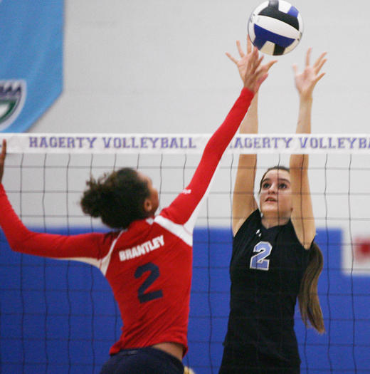 Lake Brantley's Alyssa Christian, left, and Hagerty's Jordann Marinelli battle at the net during a girls volleyball match on Thursday. Lake Brantley lost to Hagerty 3-1 (25-18, 25-7, 15-25, 25-22).