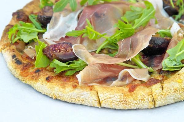 Fresh fig and prosciutto flatbread pizza from Full of Life Flatbread.