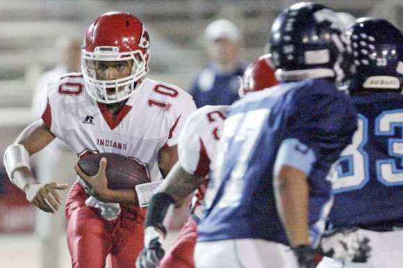 Burroughs' quarterback Andrew Williams looks for some running space against the Crescenta Valley defense.