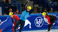 Simon Cho (blue) celebrates after winning the 2011 world title at 500 meters. (Leon Neal / AFP)