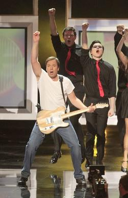 "<i>By Patrick Kevin Day and Lisa Fung</i><br> <br> We must admit having mixed feelings about host Jimmy Fallon's ""Glee""-style opening to the tune of Bruce Springsteen's ""Born to Run."" On the one hand, it's nothing new. Fallon has already done a ""Glee"" parody with the cast of ""Parks and Recreation"" on his ""Late Night"" show. But this one was done with such energy that it's hard to be a hater. Besides, who can be angry when someone's singing the Boss?"
