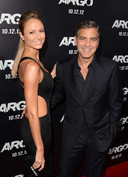 "George Clooney and Stacy Keibler walk the red carpet at the ""Argo"" movie premiere on Oct. 4, 2012."
