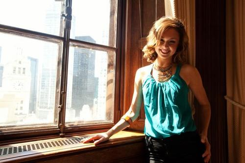 Meg poses in the wood-paneled office of Chicago Tribune founder Colonel McCormick.
