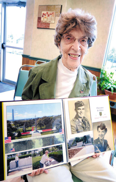 Hagerstown resident Florence ¿Flo¿ Miles served in the Women¿s Army Corps during World War II. She compiled a series of scrapbooks archiving the war. Here, Miles shows photos of herself and her older brother, Russell Daudelin, in uniform. Daudelin died during the war in North Africa.