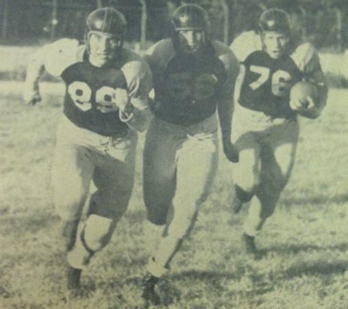 The Northern Trio of Jerry Roesch (89), MArvin Schumacher (56), and Doug eye (76) rumble down the field in 1949.