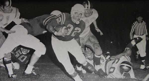 Harry Stapp (32) runs the ball for Northern in 1966.