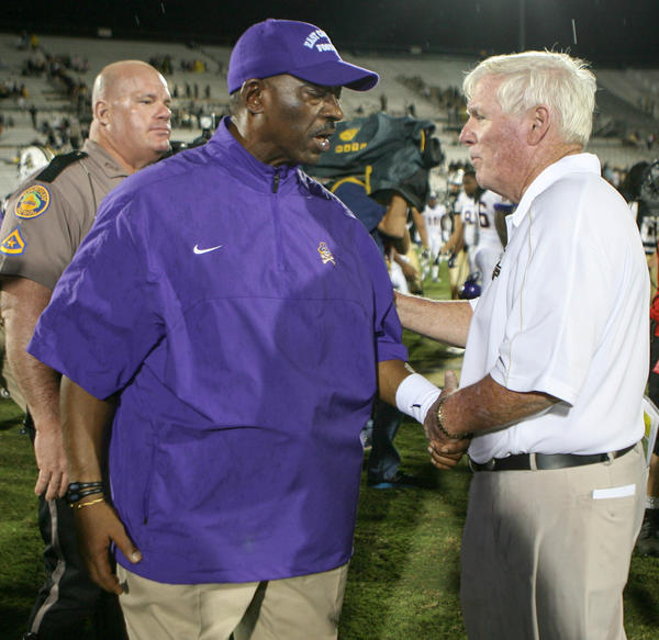 East Carolina coach Ruffin McNeill shakes hands with UCF coach George O'Leary after their 20-40 loss to UCF in a C-USA football game at the Brighthouse Networks Stadium on Thursday, October 04, 2012 in Orlando, FL.