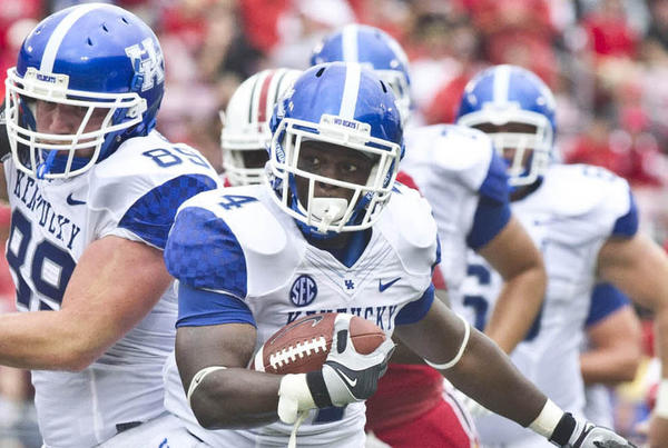 Kentucky running back Raymond Sanders breaks into open space during the Wildcats' game against Louisville last month. Sanders rushed for 59 yards last week against South Carolina, and he knows he could be needed to help the two freshman quarterbacks expected to play for the Wildcats on Saturday against Mississippi State.
