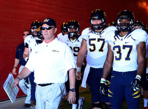 Coach Jeff Tedford of the California Golden Bears leads his team onto the field.