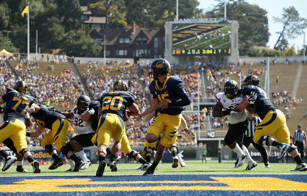 Zach Maynard of California Golden Bears hands off to Isi Sofele during their game against the Arizona State Sun Devils.