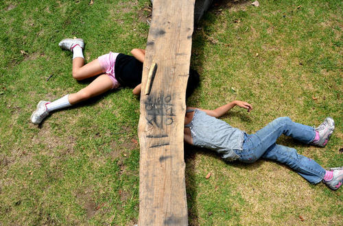 Two young campers play tic-tac-toe with charcoal at El Capitan Canyon.