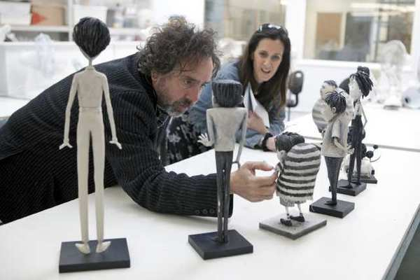 """Frankenweenie"" Director Tim Burton reviews the character maquettes in the Puppet Hospital with Producer Allison Abbate."