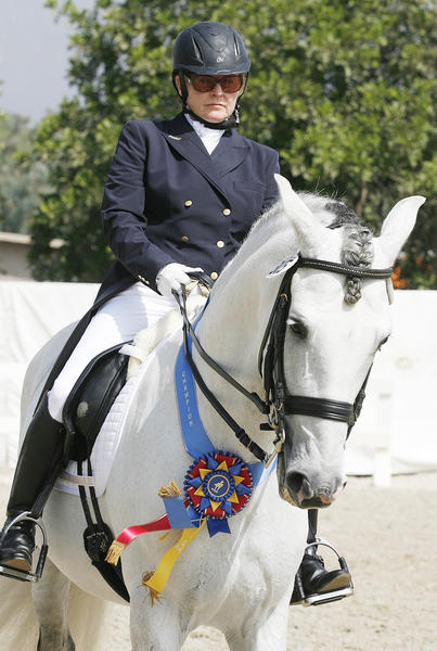Class 72 champion Cathey Cadieux, of Malibu, atop Karuso II, with the champion's ribbon, awaits the awards ceremony in the warm up area at the California Dressage Society's Annual Championship Dressage Show at the Los Angeles Equestrian Center in Burbank on Friday, October 5, 2012.
