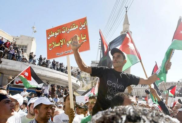 Thousands demonstrate in Amman, the capital of Jordan, for constitutional reforms.