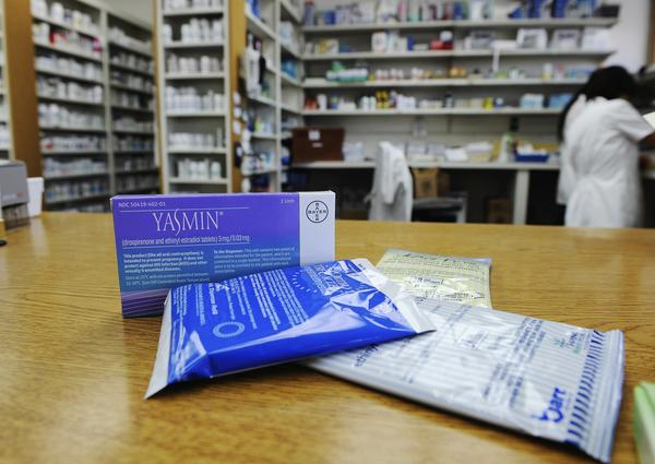 Prescription contraceptives for women sit on the counter of a drug store in Los Angeles. Under Obamacare rules, health insurers are required to cover approved contraceptives for women without co-payments or other charges.