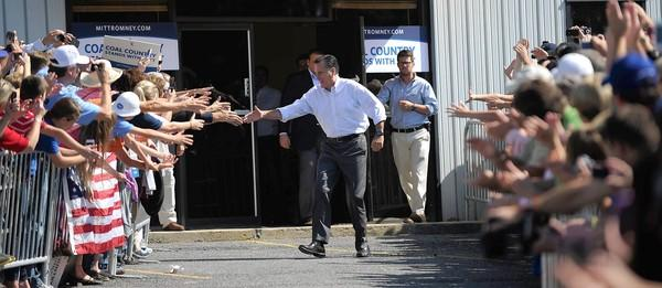 Republican presidential candidate Mitt Romney greets backers at a rally in Abingdon, Va.