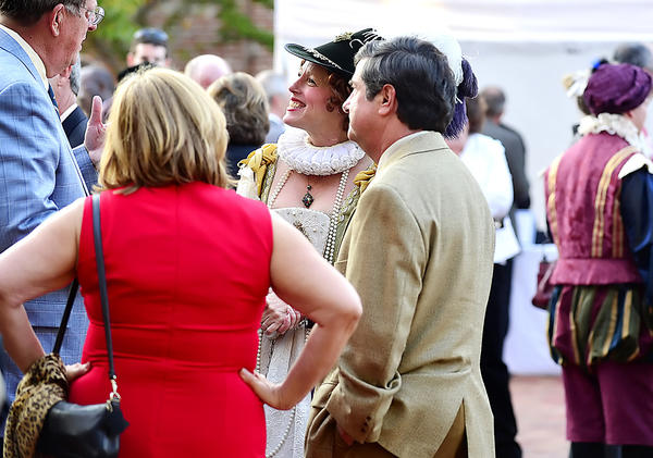 Guests attending the Elizabethtowne Feaste and Frolic fundraiser at the University System of Maryland at Hagerstown mingle with Renaissance entertainers Friday in the school's downtown courtyard.