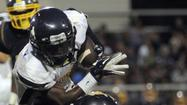 Catonsville rolls past Eastern Tech for fourth win in football