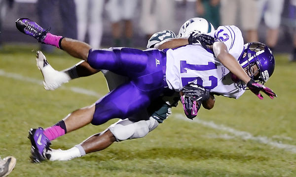 Smithsburg's Austin Ryan is brought down by South Hagerstown's Teon Maeser in the second quarter of Friday night's MVAL Antietam football game at School Stadium.