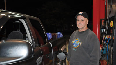 Terry Kreger, Somerset, pumps gas at the Sheetz gas station along Main Street in Somerset. Kreger, who is retired, said he tries not to drive around much, but sees how the rising prices of gas would be a burden on workers.
