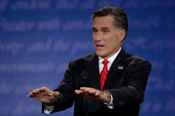 Mitt Romney participates in a presidential debate with President Obama, unseen, at the University of Denver in Colo.