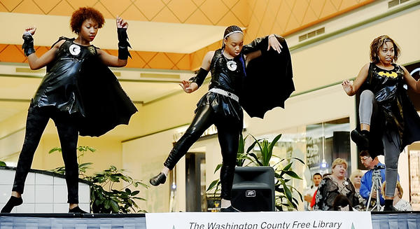 Charice Washington, left, and Hope and Heather Gayle perform at the JUST DANCE competition Friday evening at Valley Mall. The trio, from West Virginia, is known as 1 Luv.