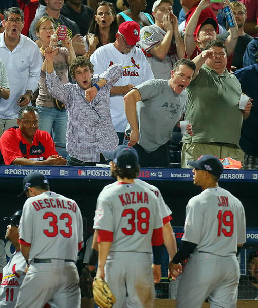 Atlanta Braves fan jeer at St. Louis Cardinals players leaving the field in the eighth inning, after umpires called an infield fly rule on the Braves' Andrelton Simmons, which resulted in the National League Wild Card game being stopped due to debris on the field at Turner Field in Atlanta, Georgia, Friday, October 5, 2012. The Cardinals defeated the Braves, 6-3, and will play the Washington Nationals in a National League Division Series.