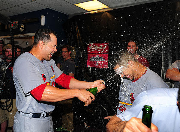 Carlos Beltran #3 of the St. Louis Cardinals celebrates with Jon Jay #19 after the game against the Atlanta Braves during the National League Wild Card Game at Turner Field on October 5, 2012 in Atlanta, Georgia.